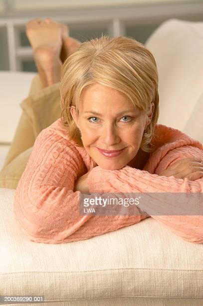 Mature woman on sofa, portrait