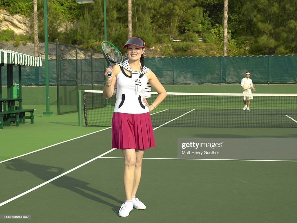 Mature woman on tennis court, portrait : Stock Photo
