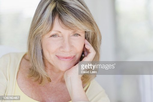 Mature woman, portrait, smiling, close up : Stock Photo