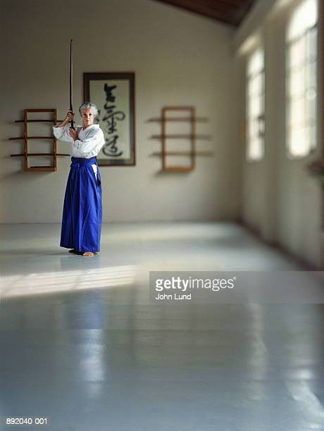 Mature woman practising Aikido