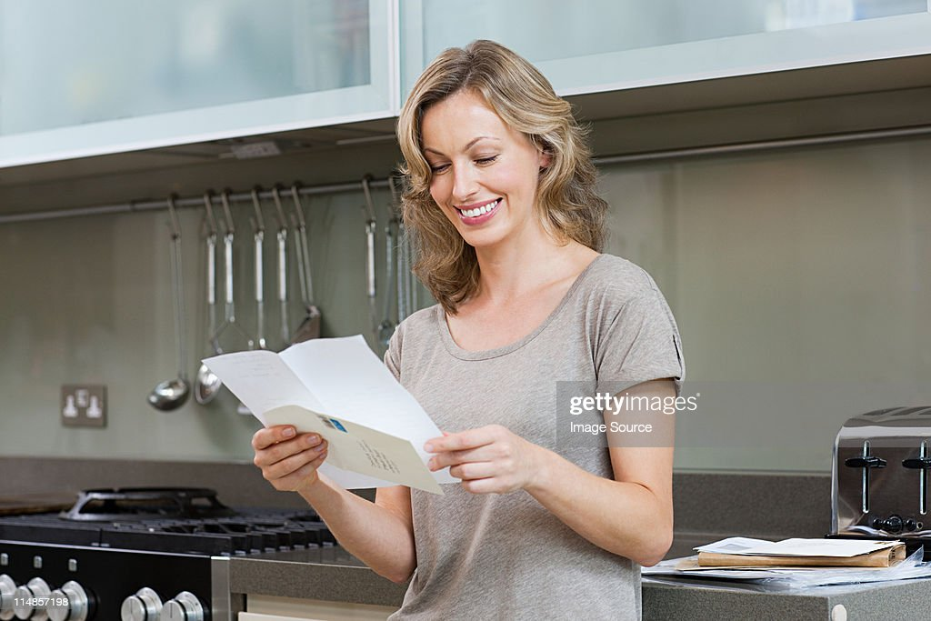 Mature woman reading letter : Stock Photo