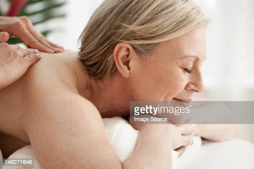 Mature woman receiving massage : Stock Photo