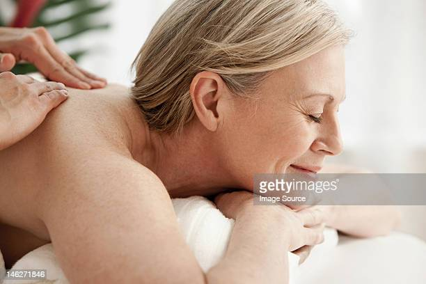 Mature woman receiving massage