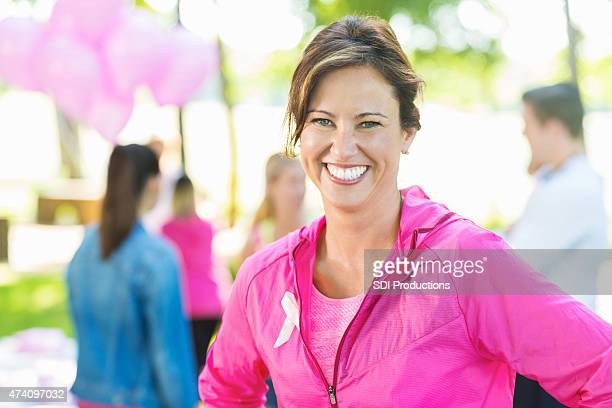 Mature woman registering for breast cancer charity marathon or race