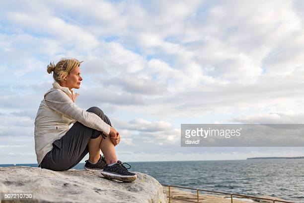Mature Woman Relaxing After Hiking by the Sydney Seaside Australia