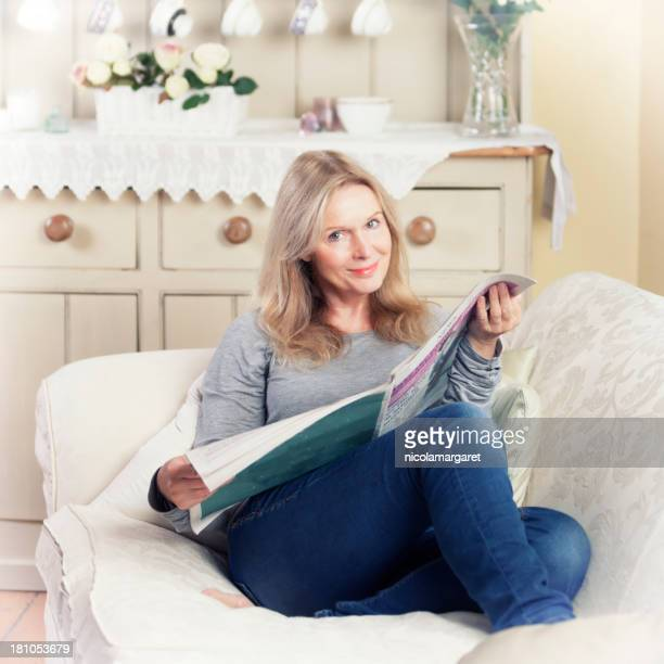 Mature woman relaxing reading the paper