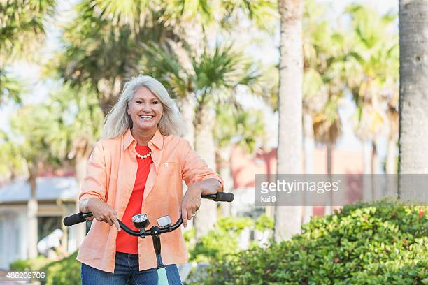Mature woman riding bicycle in the park