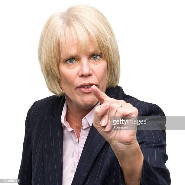 Mature Woman Shakes Finger at Camera