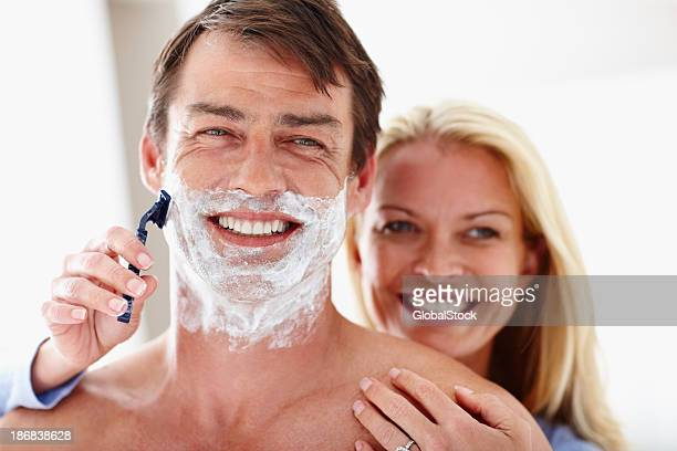 Mature woman shaving her husband