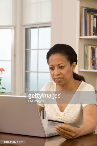 Mature woman shopping online with credit card : Stock Photo