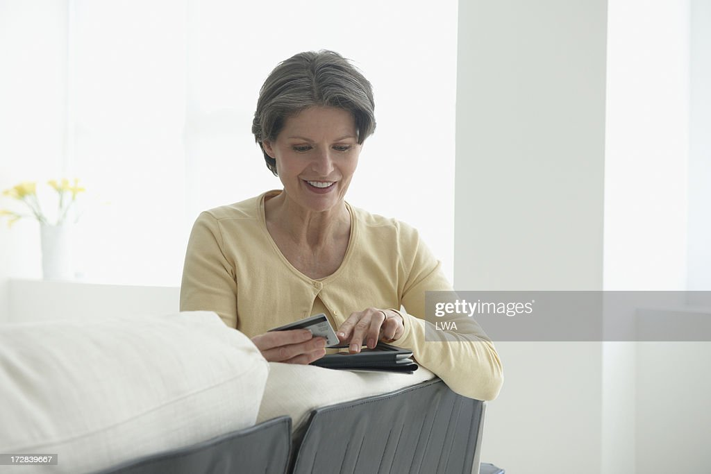 Mature woman shopping online with digital tablet : Stock Photo