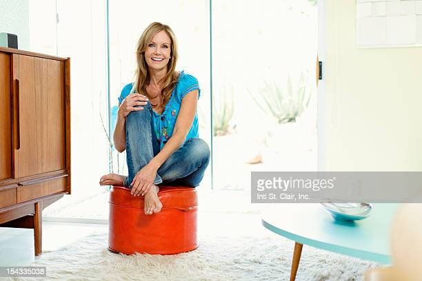 Footstool stock photos and pictures getty images for Ottoman to sit on