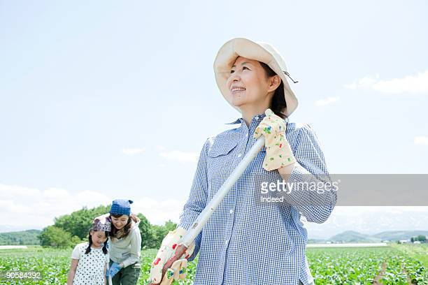 Mature woman smiling on vegetable field