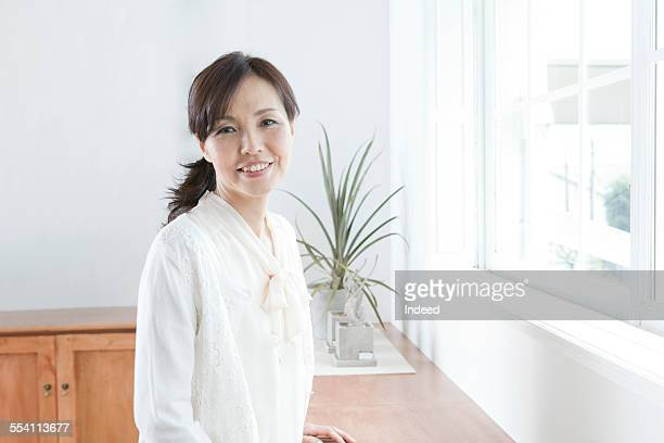 A mature woman smiling