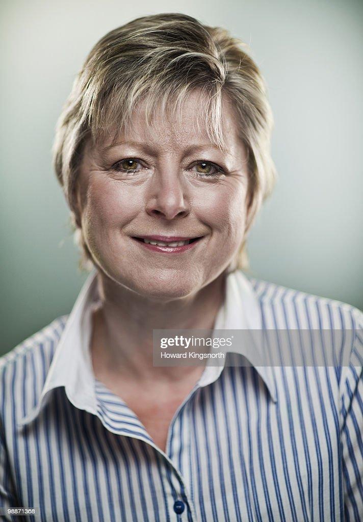 Mature woman smiling, portrait : Stock Photo