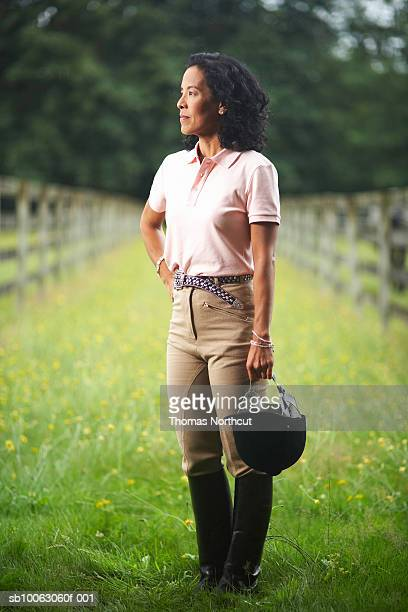 Mature woman standing in field