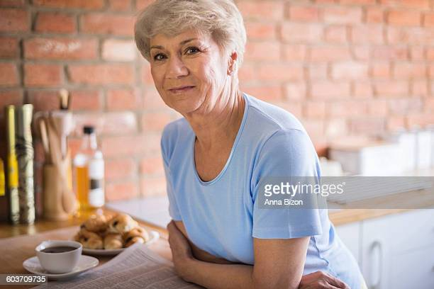 Mature woman standing in the kitchen. Debica, Poland