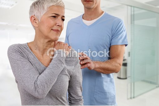 Mature Woman suffering from back pain during medical exam. Chiropractic, osteopathy, Physiotherapy. Alternative medicine, pain relief concept. : Stock Photo