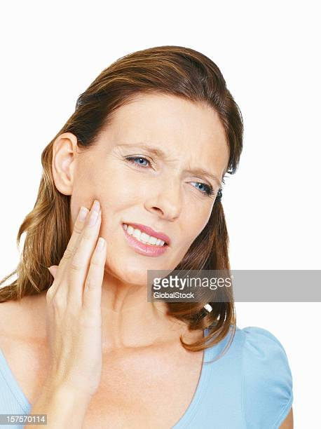 Mature woman suffering from toothache