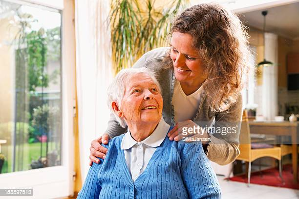 mature woman taking care of senior