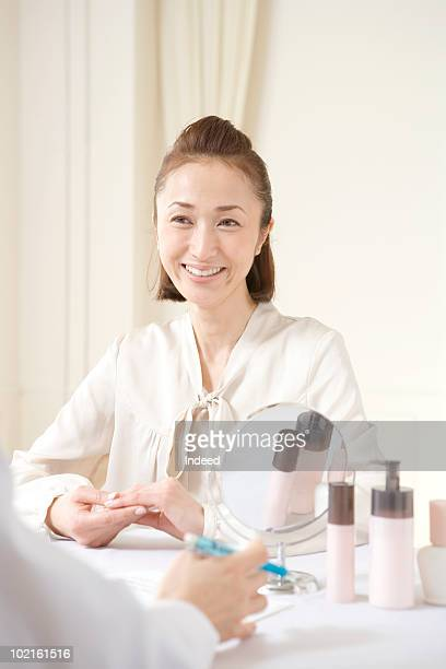 Mature woman talking with a beauty expert