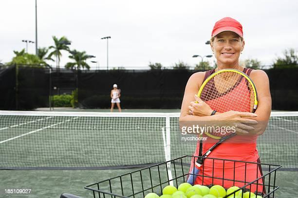 mature woman tennis coach