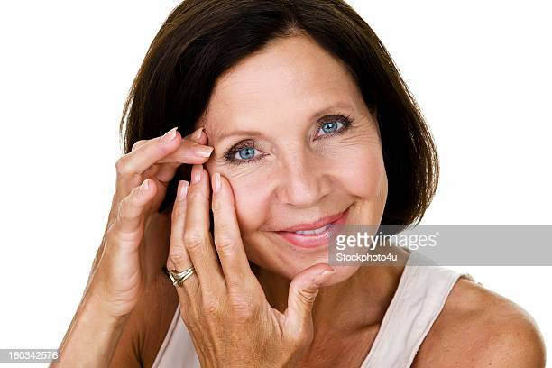 Mature woman touching her face