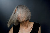 Mature woman turning head, close-up
