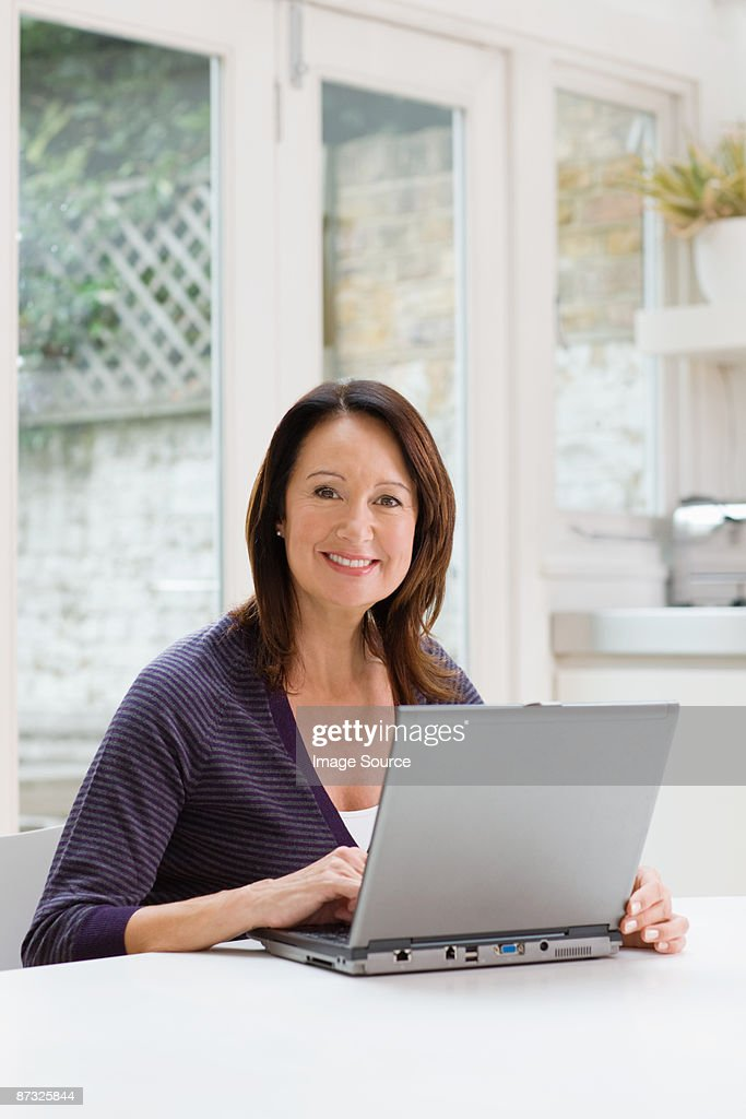 Mature woman using a laptop : Stock Photo