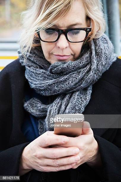 Mature woman using cell phone