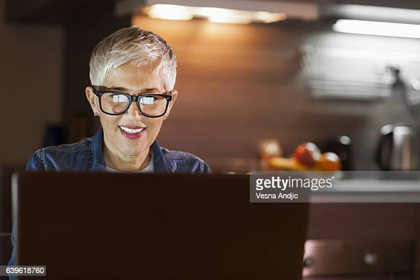 Mature woman using computer