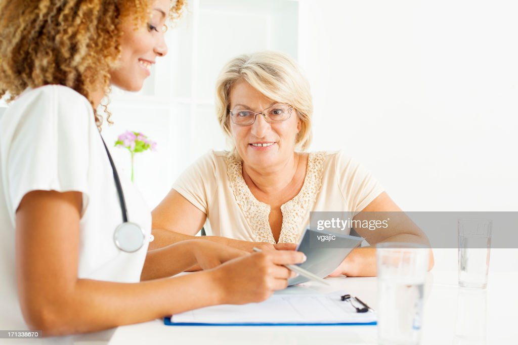 Mature Woman Visit Doctor. : Stock Photo