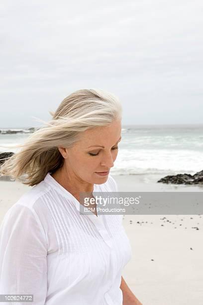 Mature woman walking at beach