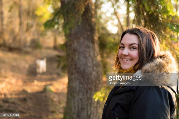 Mature woman walking in forest