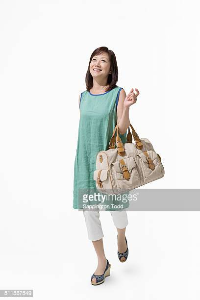 Mature Woman Walking With Travel Bag