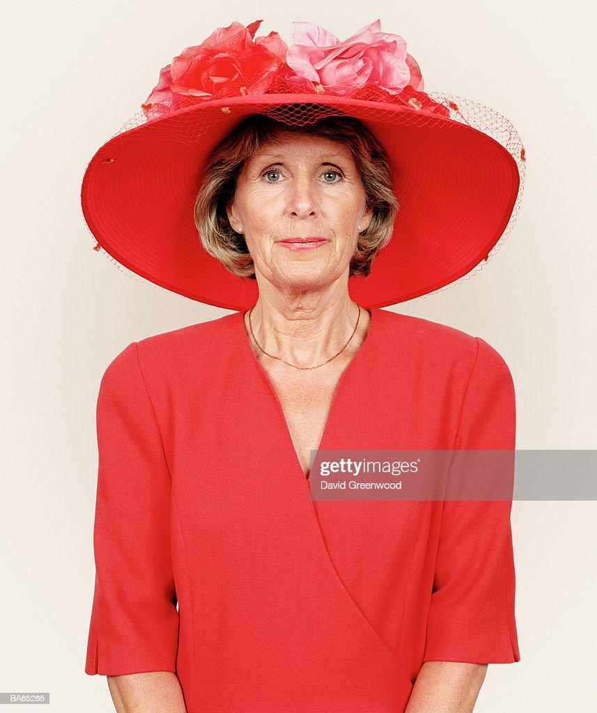 Mature woman wearing floral hat, portrait