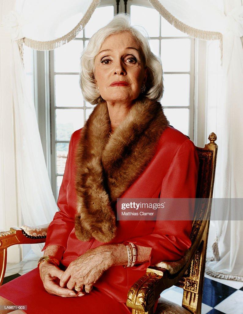 Mature woman wearing fur wrap, portrait : Stock Photo
