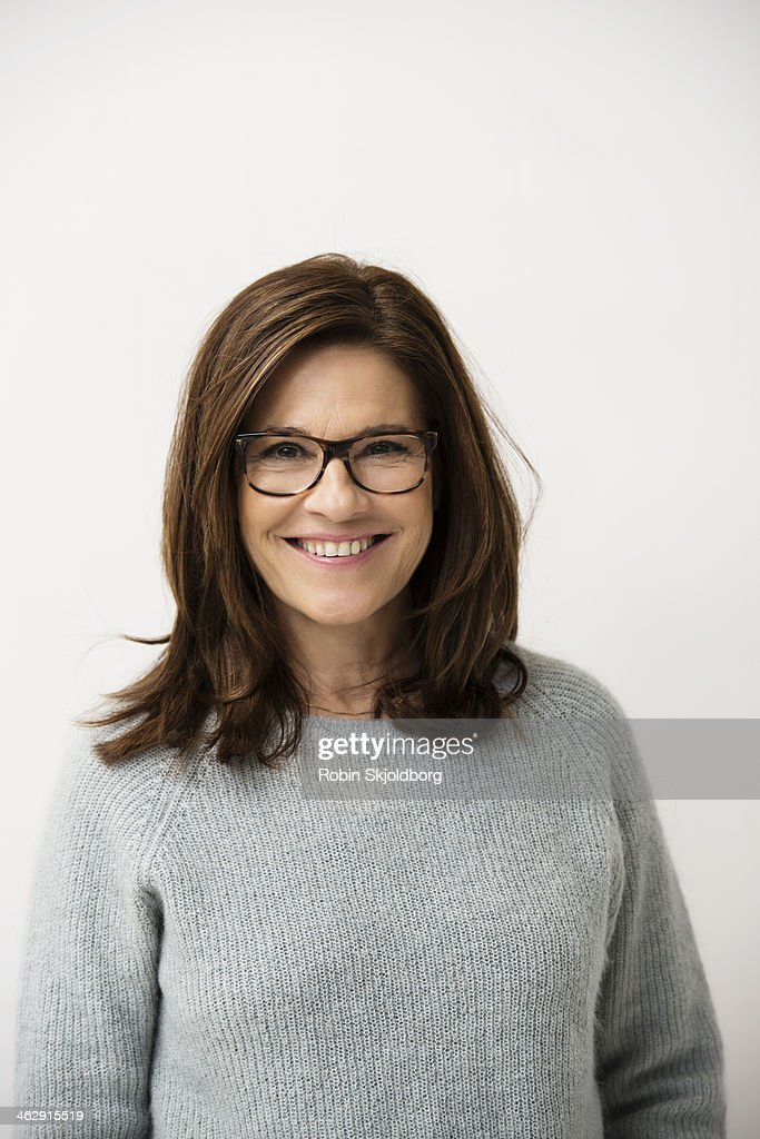 Mature woman wearing glases smiling : Stock Photo