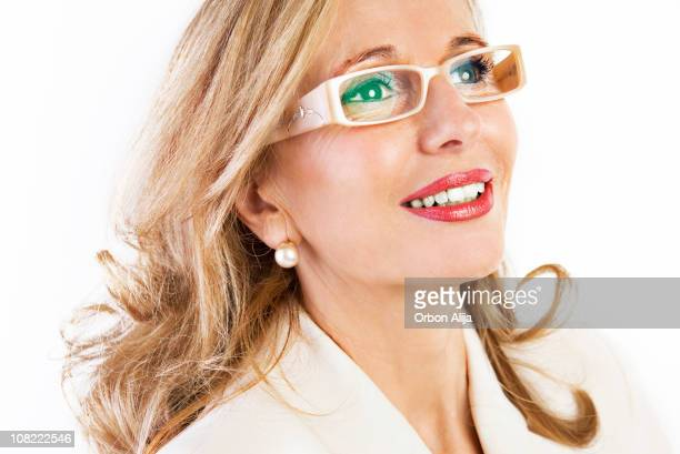 Mature Woman Wearing Glasses and Pearl Earrings