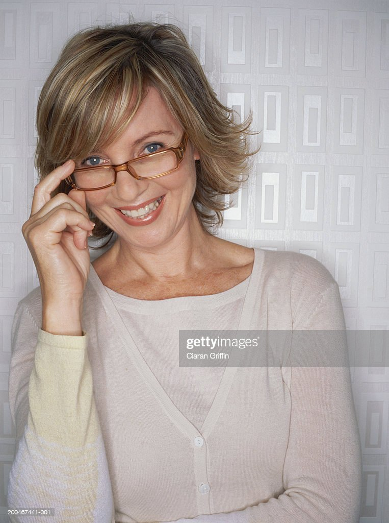 Mature woman wearing spectacles, smiling, portrait : Stock Photo