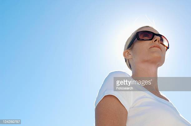 Mature woman wearing sunglasses (low angle view)