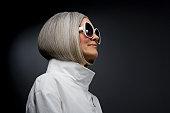 Mature woman wearing sunglasses, side view, close-up