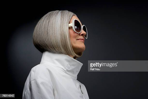 Mature woman wearing sunglasses, side view, close-up
