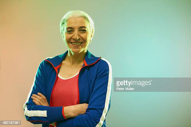 Mature woman wearing tracksuit top