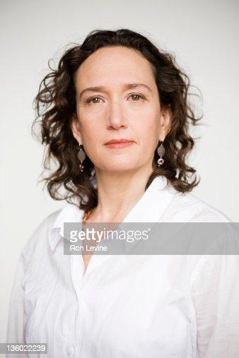 Mature woman wearing white blouse, portrait