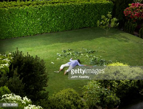 Mature woman who has fallen in backyard