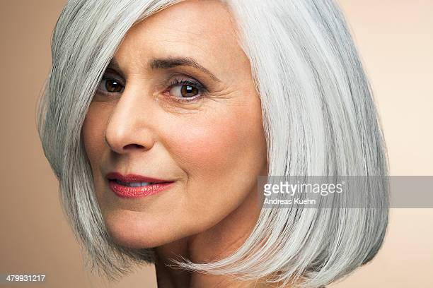 Mature woman with a grey haired bob, portrait.
