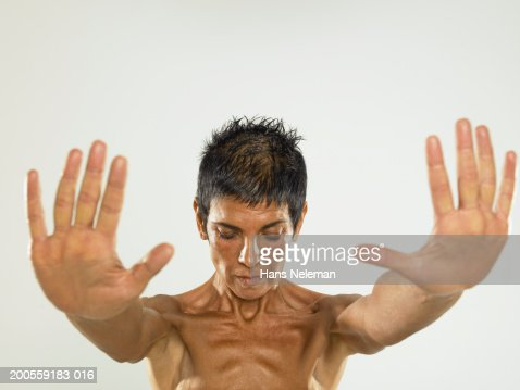 Mature woman with arms outstretched, close-up : Stock Photo