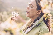 Mature woman with dandelion