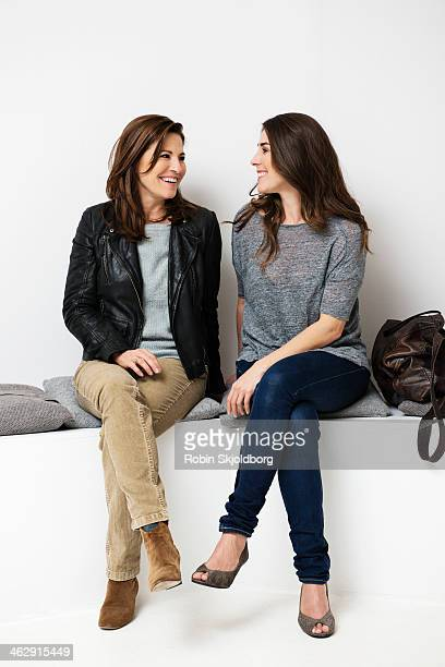 Mature woman with daughter laughing